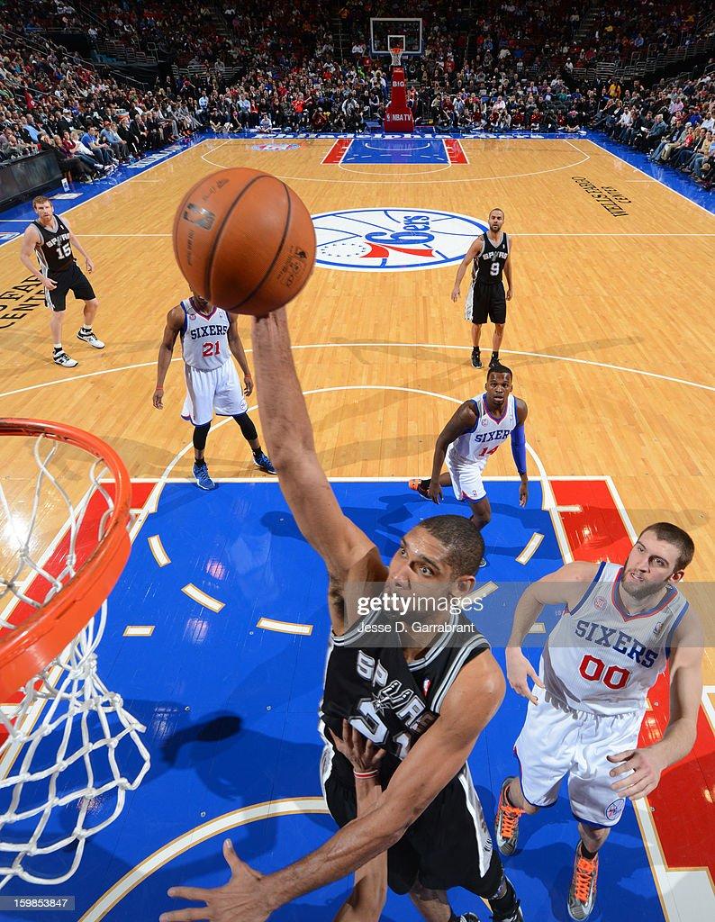 Tim Duncan #21 of the San Antonio Spurs dunks against Spencer Hawes #00 of the Philadelphia 76ers during the game at the Wells Fargo Center on January 21, 2013 in Philadelphia, Pennsylvania.