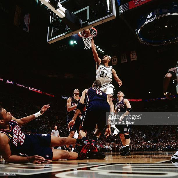 Tim Duncan of the San Antonio Spurs dunks against the New Jersey Nets during Game one of the NBA Finals at the SBC Center on June 4, 2003 in San...