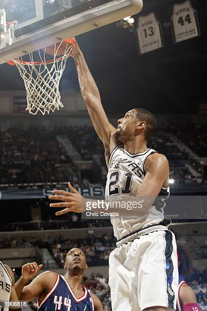 Tim Duncan of the San Antonio Spurs dunks during the NBA game against the Houston Rockets at SBC Center on March 27 2003 in San Antonio Texas The...