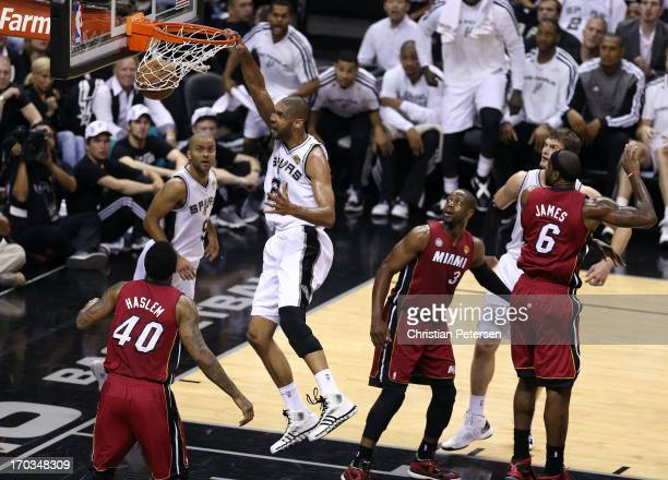 Tim Duncan of the San Antonio Spurs dunks the ball against Udonis Haslem of the Miami Heat in the first quarter during Game Three of the 2013 NBA...
