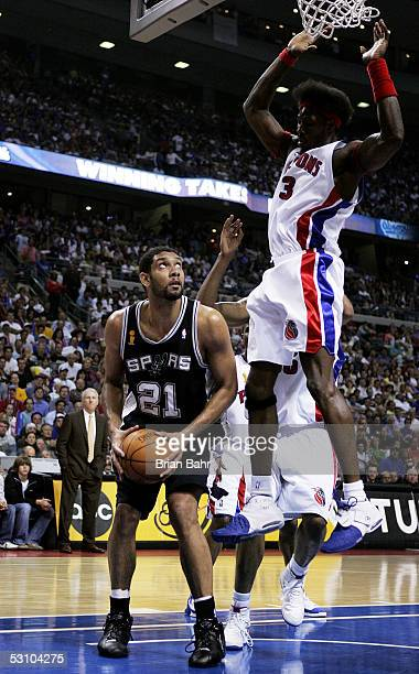 Tim Duncan of the San Antonio Spurs gets under Ben Wallace of the Detroit Pistons to score in the third quarter of Game five of the 2005 NBA Finals...