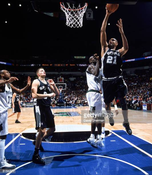 Tim Duncan of the San Antonio Spurs goes for a layup past Kevin Garnett of the Minnesota Timberwolves during a game at Target Center on March 23 2004...