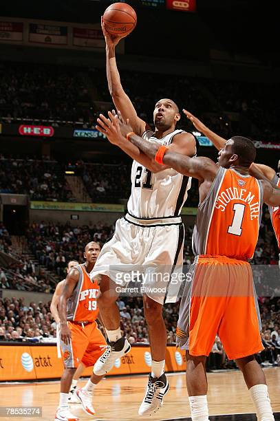 Tim Duncan of the San Antonio Spurs goes to the basket against Amare Stoudemire of the Phoenix Suns on December 17 2007 at the ATT Center in San...