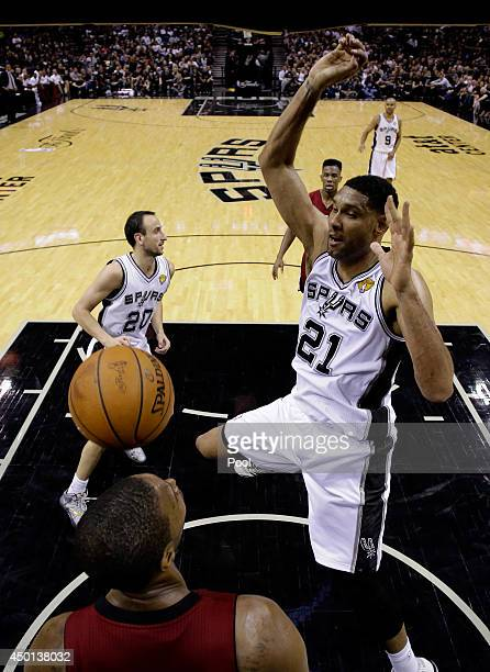 Tim Duncan of the San Antonio Spurs goes to the basket against Chris Bosh of the Miami Heat during Game One of the 2014 NBA Finals at the ATT Center...