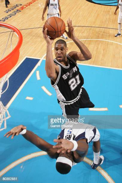 Tim Duncan of the San Antonio Spurs goes to the basket against Josh Howard of the Dallas Mavericks on March 23 2008 at the American Airlines Center...