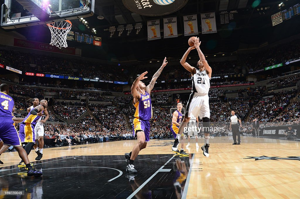 Tim Duncan #21 of the San Antonio Spurs goes to the basket against Robert Sacre #50 of the Los Angeles Lakers during the game between the Los Angeles Lakers and the San Antonio Spurs on January 9, 2013 at the AT&T Center in San Antonio, Texas.