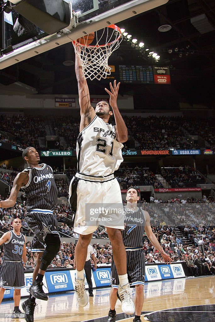 Tim Duncan #21 of the San Antonio Spurs goes to the hoop for a dunk against the Orlando Magic at AT&T Center on March 2, 2007 in San Antonio, Texas. The Spurs won 98-74.