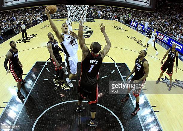 Tim Duncan of the San Antonio Spurs goes up for a shot over Chris Bosh of the Miami Heat in the second half during Game Four of the 2013 NBA Finals...