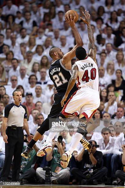 Tim Duncan of the San Antonio Spurs goes up for a shot over Udonis Haslem of the Miami Heat in the first quarter during Game Two of the 2013 NBA...