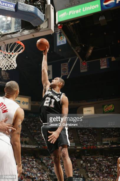 Tim Duncan of the San Antonio Spurs goes up for a slam dunk in Game five of the 2003 NBA Finals against the New Jersey Nets at Continental Airlines...