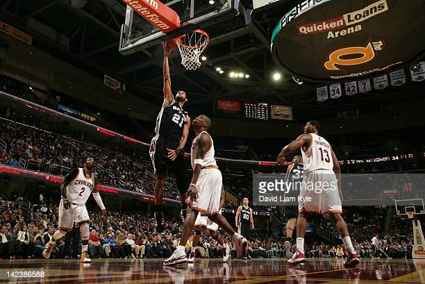 Tim Duncan of the San Antonio Spurs goes up for the dunk against Kyrie Irving Antawn Jamison and Tristan Thompson of the Cleveland Cavaliers at The...
