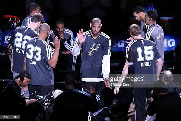 Tim Duncan of the San Antonio Spurs greets his teammates during player introductions against the Memphis Grizzlies during Game One of the Western...