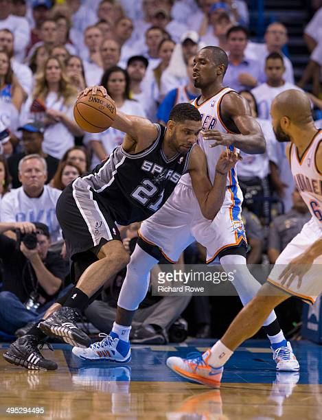 Tim Duncan of the San Antonio Spurs handles the ball against Serge Ibaka of the Oklahoma City Thunder in Game 6 of the Western Conference Finals...