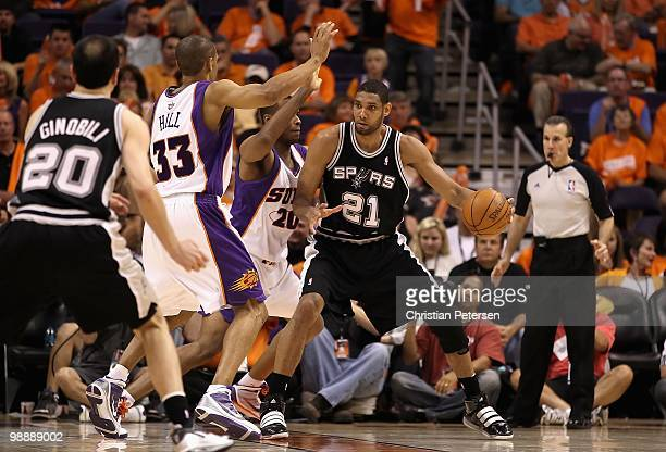 Tim Duncan of the San Antonio Spurs handles the ball against the Phoenix Suns during Game One of the Western Conference Semifinals of the 2010 NBA...