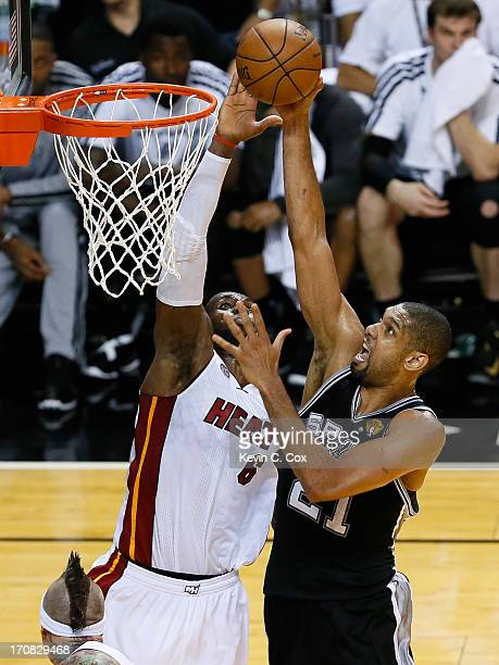 Tim Duncan of the San Antonio Spurs has his shot blocked by LeBron James of the Miami Heat in the fourth quarter during Game Six of the 2013 NBA...