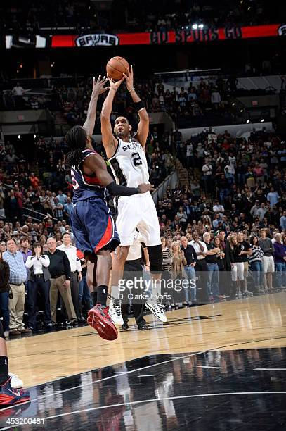 Tim Duncan of the San Antonio Spurs hits the game winning shot against the Atlanta Hawks during the game at the ATT Center on December 2 2013 in San...