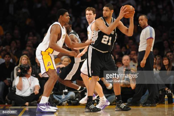 Tim Duncan of the San Antonio Spurs holds the ball in the post against Andrew Bynum of the Los Angeles Lakers at Staples Center on January 25 2009 in...