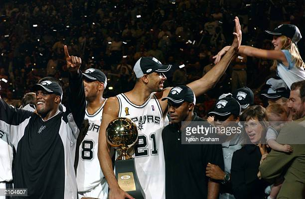 Tim Duncan of the San Antonio Spurs holds the MVP Trophy after defeating the New Jersey Nets in Game six of the 2003 NBA Finals at SBC Center on June...