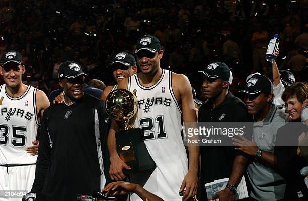 Tim Duncan of the San Antonio Spurs holds the MVP Trophy award after defeating the New Jersey Nets in Game six of the 2003 NBA Finals at SBC Center...