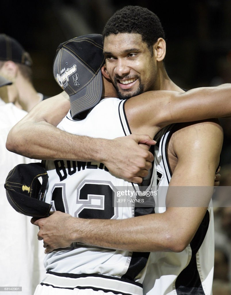 Tim Duncan (R) of the San Antonio Spurs hugs teaqmmate Bruce Bowen (L) after their game against the Detroit Pistons in the NBA Finals game seven 23 June, 2005 at the SBC Center in San Antonio, Texas. The Spurs won the game 81-74 to win the seven game series 4-3.