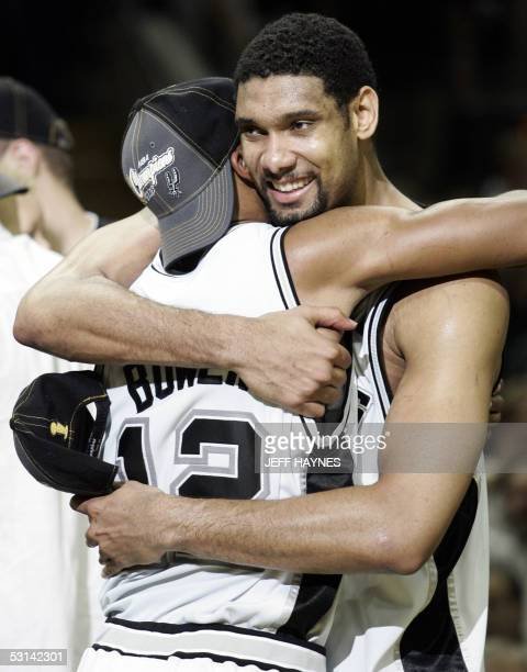 Tim Duncan of the San Antonio Spurs hugs teaqmmate Bruce Bowen after their game against the Detroit Pistons in the NBA Finals game seven 23 June 2005...