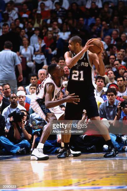 Tim Duncan of the San Antonio Spurs in the post against Dikembe Mutombo of the New Jersey Nets during Game four of the NBA finals at the Continental...