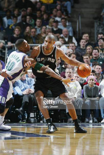 Tim Duncan of the San Antonio Spurs is defended by Ervin Johnson of the Milwaukee Bucks during the game at Bradley Center on March 11 2003 in...