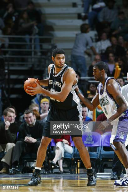 Tim Duncan of the San Antonio Spurs is defended by Joe Smith of the Milwaukee Bucks during the game on December 4 2004 at the Bradley Center in...