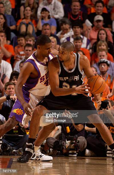 Tim Duncan of the San Antonio Spurs is guarded by Kurt Thomas of the Phoenix Suns in Game Five of the Western Conference Semifinals during the 2007...