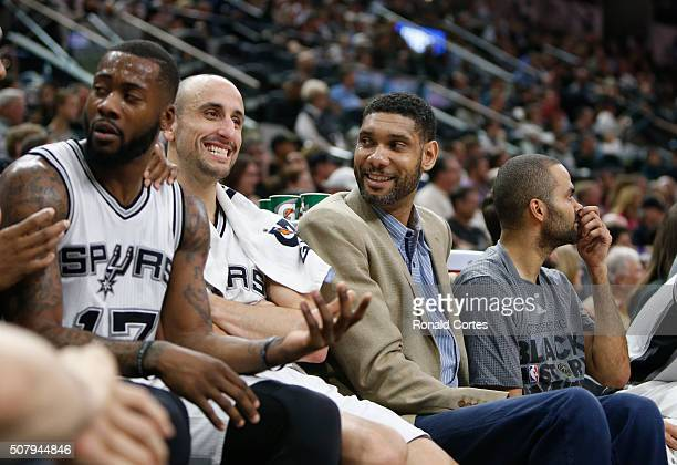 Tim Duncan of the San Antonio Spurs jokes with Manu Ginobili during a timeout against the Orlando Magic at ATT Center on February 1 2016 in San...