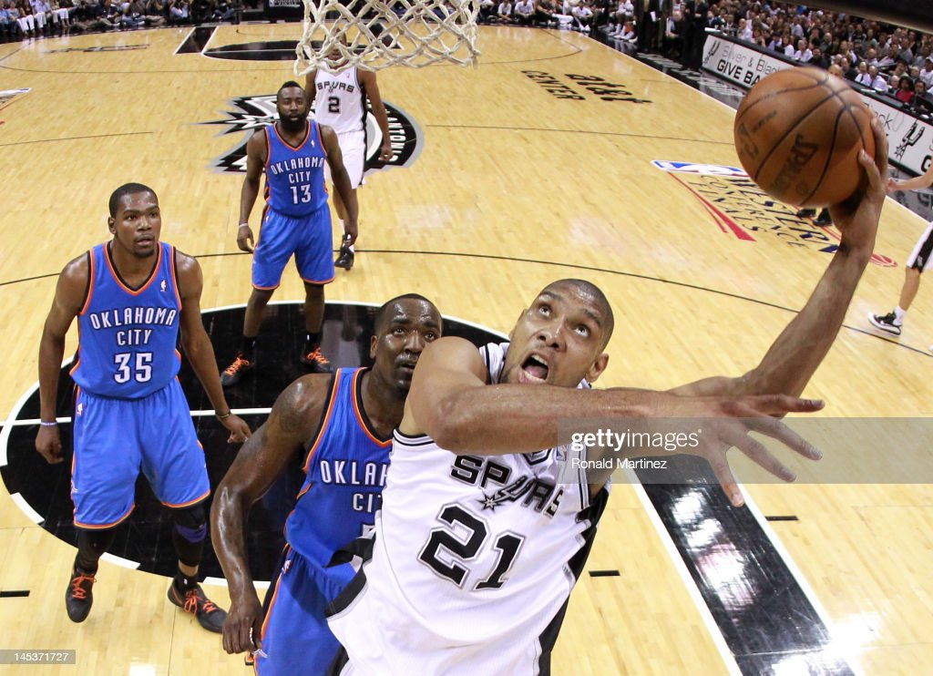 Tim Duncan #21 of the San Antonio Spurs lays the ball up in front of Kendrick Perkins #5 of the Oklahoma City Thunder in the second half in Game One of the Western Conference Finals of the 2012 NBA Playoffs at AT&T Center on May 27, 2012 in San Antonio, Texas.