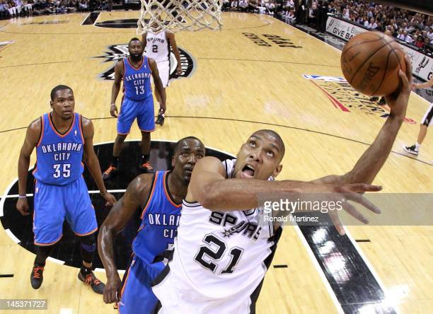 Tim Duncan of the San Antonio Spurs lays the ball up in front of Kendrick Perkins of the Oklahoma City Thunder in the second half in Game One of the...