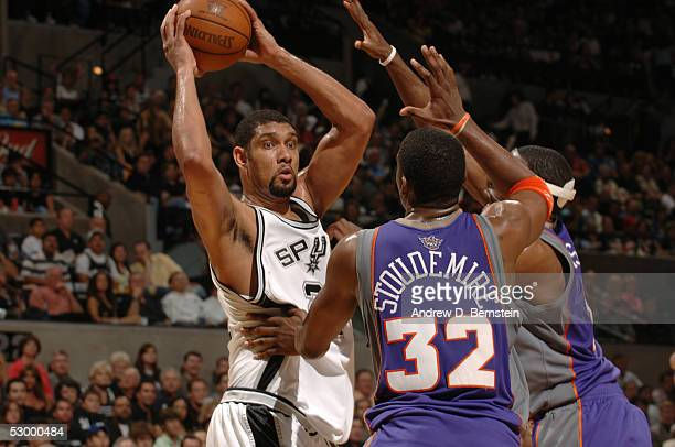 Tim Duncan of the San Antonio Spurs looks for help against Amare Stoudemire and Joe Johnson of the Phoenix Suns in Game four of the Western...
