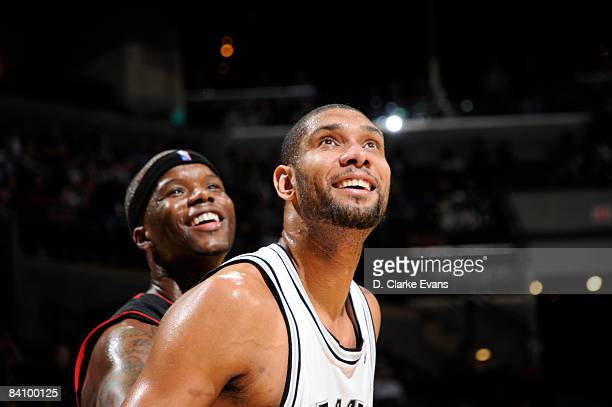Tim Duncan of the San Antonio Spurs looks for the rebound against Jermaine O'Neal of the Toronto Raptors on December 20 2008 at the ATT Center in San...