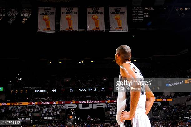 Tim Duncan of the San Antonio Spurs looks in the direction of the team's four championship banners while playing against the Los Angeles Clippers in...
