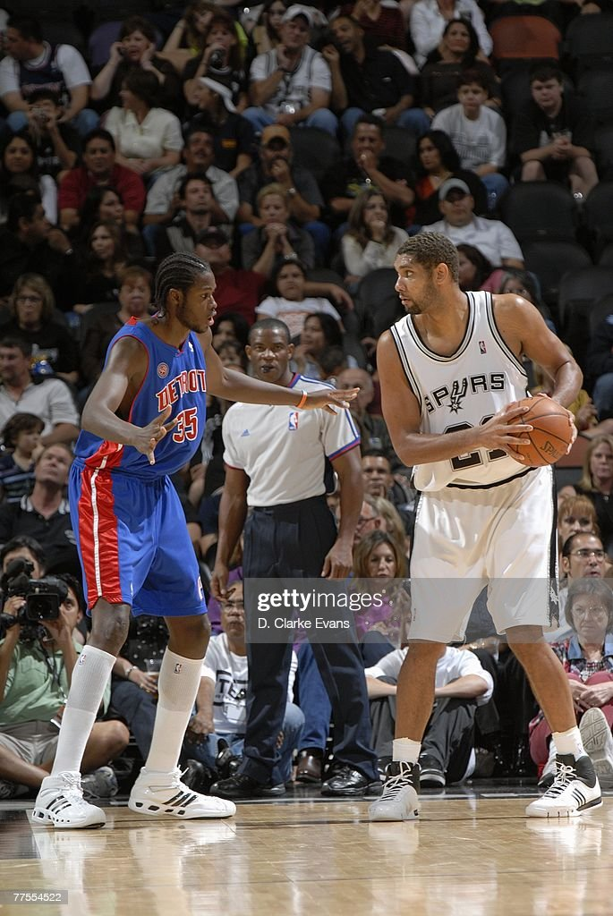 Tim Duncan #21 of the San Antonio Spurs looks to make a move against Cheikh Samb #35 of the Detroit Pistons during a preseason game at AT&T Center on October 20, 2007 in San Antonio, Texas. The Spurs won 104-80.