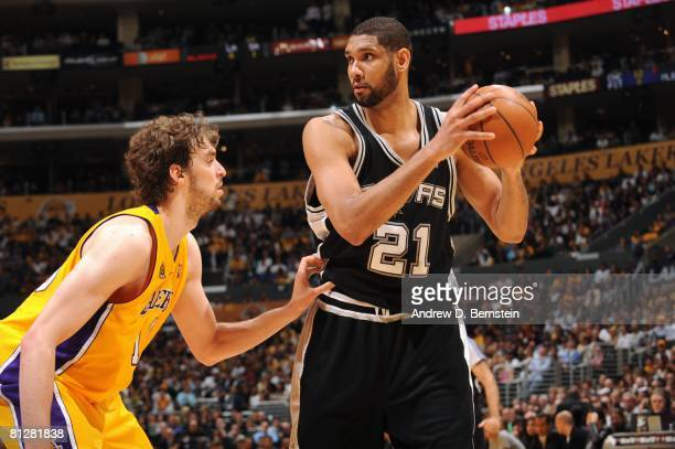 Tim Duncan of the San Antonio Spurs looks to make a move against Pau Gasol of the Los Angeles Lakers in Game Two of the Western Conference Finals...