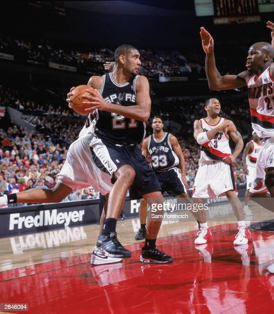 Tim Duncan of the San Antonio Spurs looks to make a play against the Portland Trail Blazers during the game on December 20 2003 at the Rose Garden in...