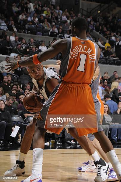 Tim Duncan of the San Antonio Spurs looks to move the ball against Amare Stoudemire of the Phoenix Suns during the game on December 17 2007 at the...