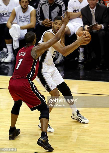 Tim Duncan of the San Antonio Spurs looks to pass as Chris Bosh of the Miami Heat defends during Game One of the 2014 NBA Finals at the ATT Center on...