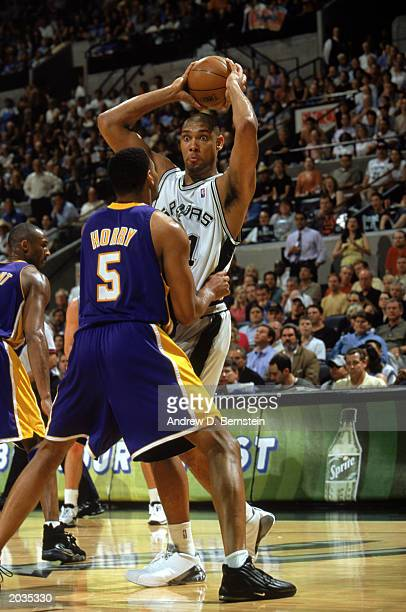 Tim Duncan of the San Antonio Spurs looks to pass over Robert Horry of the Los Angeles Lakers in Game One of the Western Conference Semifinals during...