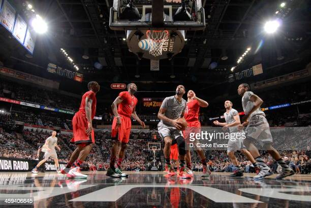 Tim Duncan of the San Antonio Spurs looks to shoot the ball against the Houston Rockets during the game at the ATT Center on December 25 2013 in San...