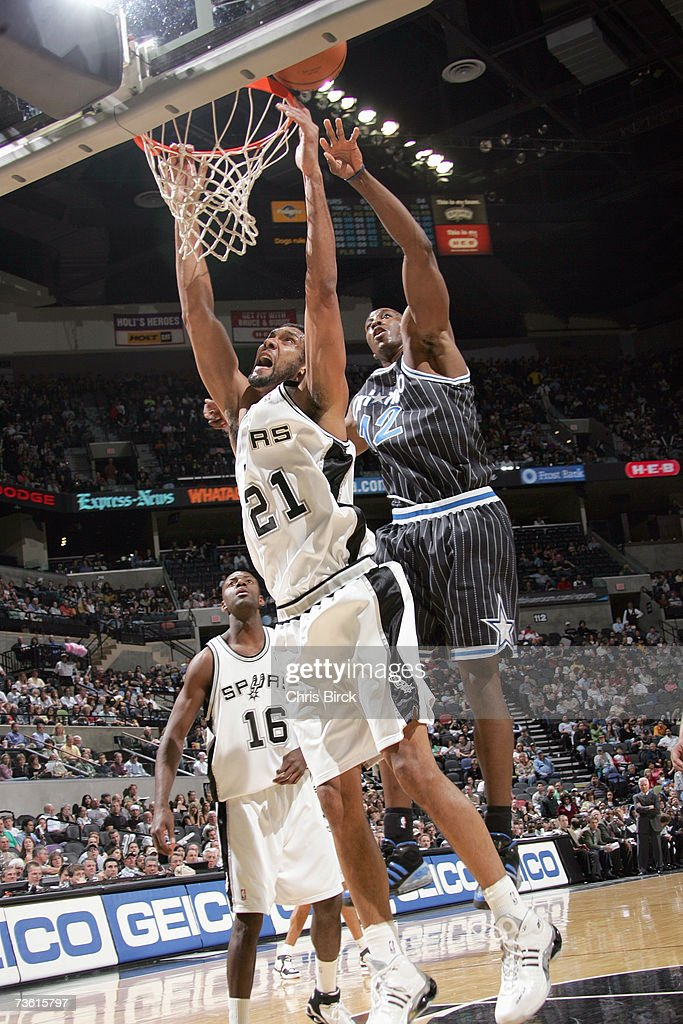 Tim Duncan #21 of the San Antonio Spurs misses the dunk past Dwight Howard #12 of the Orlando Magic at AT&T Center on March 2, 2007 in San Antonio, Texas. The Spurs won 98-74.