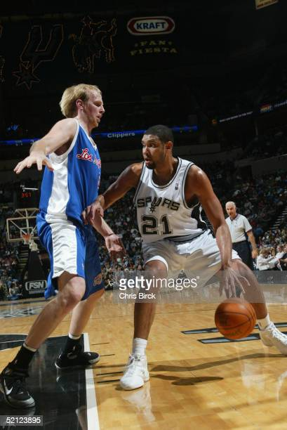 Tim Duncan of the San Antonio Spurs moves the ball against Chris Kaman of the Los Angeles Clippers during the game on January 19 2005 at the SBC...