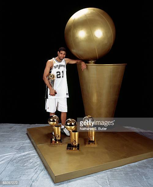 Tim Duncan of the San Antonio Spurs poses with his championship trophies after winning Game Seven of the 2005 NBA Finals June 23 2005 at the SBC...
