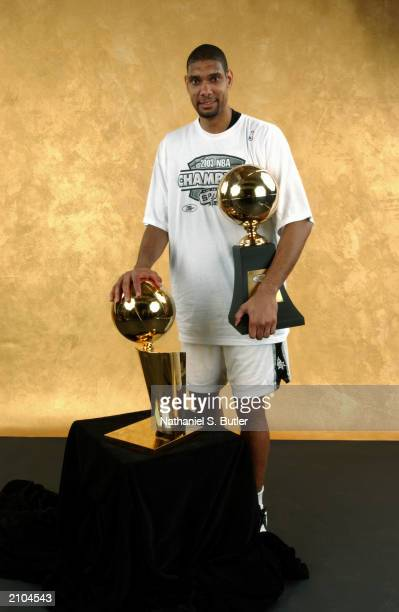 Tim Duncan of the San Antonio Spurs poses with the Larry O'Brien trophy after defeating the New Jersey Nets in Game six of the 2003 NBA Finals at SBC...