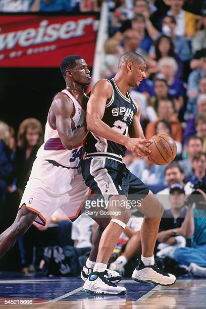 Tim Duncan of the San Antonio Spurs posts up against Antonio McDyess of the Phoenix Suns during Game 1 of the First Round of the Western Conference...