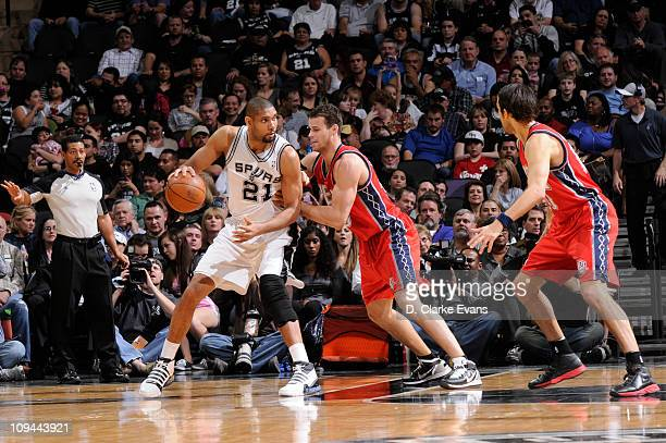 Tim Duncan of the San Antonio Spurs posts up against Kris Humphries of the New Jersey Nets at ATT Center on February 25 2011 in San Antonio Texas...