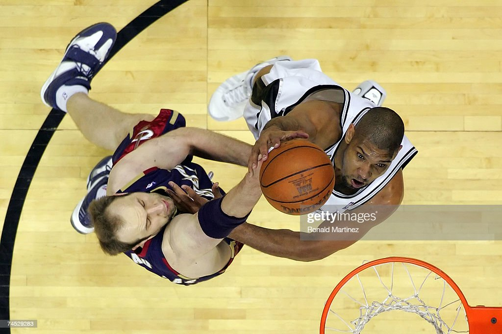 Tim Duncan #21 of the San Antonio Spurs puts a shot up over Zydrunas Ilgauskas #11 of the Cleveland Cavaliers in Game Two of the 2007 NBA Finals on June 10, 2007 at the AT&T Center in San Antonio, Texas.