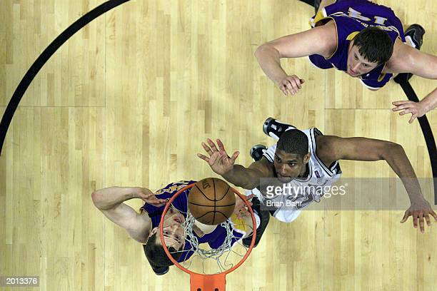 Tim Duncan of the San Antonio Spurs puts in a shot against the Los Angeles Lakers in Game five of the Western Conference Semifinals during the 2003...